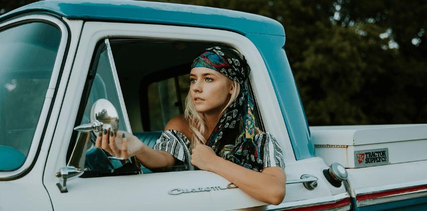 Blonde driver in a pickup truck